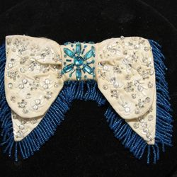"""Western bowtie: """"Inside Out: Liberace and the Art of Costume"""" features a collection of bowties and boots worn by Liberace. Inspiration for many of his costumes came from the American West, the adopted home of the Milwaukee-born pianist. This beaded bowtie"""