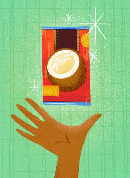 A brown hand holds up a red can of coconut milk against a light green background.