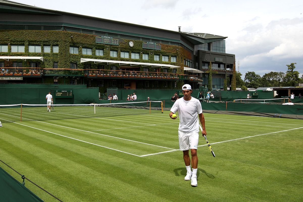 LONDON, ENGLAND - JUNE 23:  Rafael Nadal of Spain participates in a practice session on the outside courts during previews to The Championships at Wimbledon on June 23, 2012 in London, England.  (Photo by Clive Rose/Getty Images)
