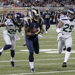 St. Louis Rams wide receiver Chris Givens (13) makes a reception against Seattle Seahawks cornerback Richard Sherman (25) and  Earl Thomas (29) during the first half of an NFL football game Sunday, Sept. 30, 2012, in St. Louis.