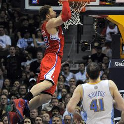 Los Angeles Clippers forward Blake Griffin,left, dunks over Denver Nuggets center Kosta Koufos (41) during the second quarter of an NBA basketball game on Wednesday, April 18, 2012, in Denver.