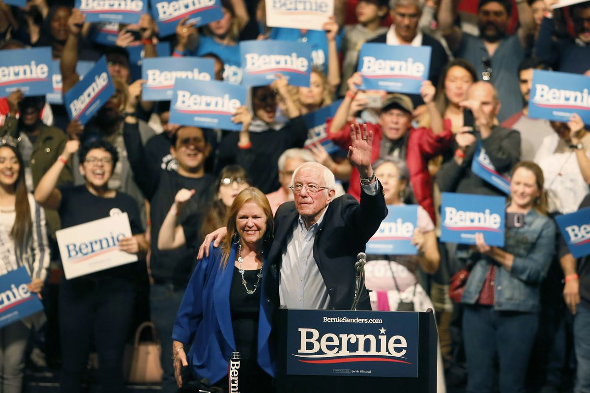 Democratic presidential candidate Sen. Bernie Sanders, I-Vt., with his wife Jane O'Meara Sanders, waves his hand during a rally Saturday in El Paso, Texas.