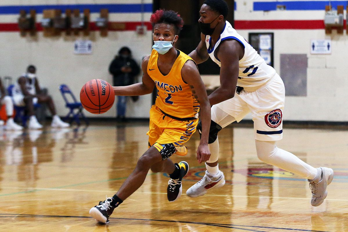 Simeon's Jalen Griffith (2) beats one defender and then drives the lane against Curie.