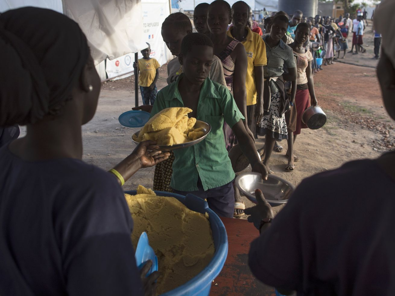 Sudanese refugees receiving food in Kuluba, Uganda. Kuluba and other northern cities were targeted in this cash program.