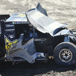Rob MacCachren in the 21 Rockstar truck tries to drive with his front cover blocking his view as racers compete in the Pro 2 division in the Lucas Off-Road races in Tooele on Saturday, June 24, 2017.
