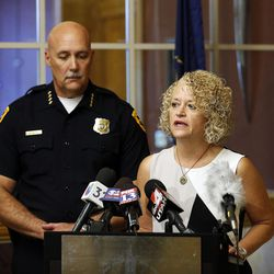 Salt Lake City Police Chief Mike Brown listens to Mayor Jackie Biskupski during a press conference at the City-County Building in Salt Lake City on Friday, Sept. 1, 2017, concerning a University Hospital nurse who was arrested for not allowing a blood draw by a Salt Lake police officer.