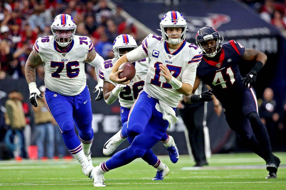 Buffalo Bills quarterback Josh Allen runs the b all against Houston Texans inside linebacker Zach Cunningham during the second quarter in the AFC Wild Card NFL Playoff game at NRG Stadium.
