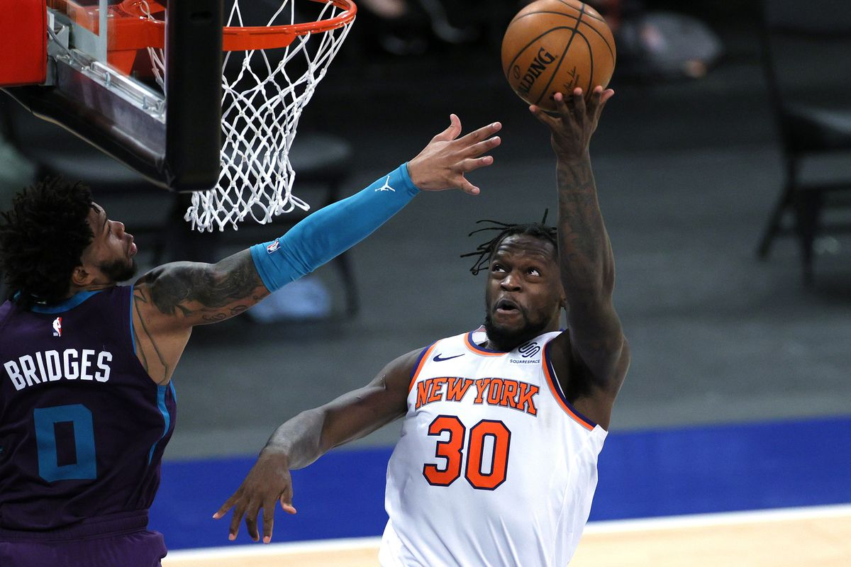 Julius Randle #30 of the New York Knicks goes to the basket as Miles Bridges #0 of the Charlotte Hornets defends during the second half at Madison Square Garden on April 20, 2021 in New York City.