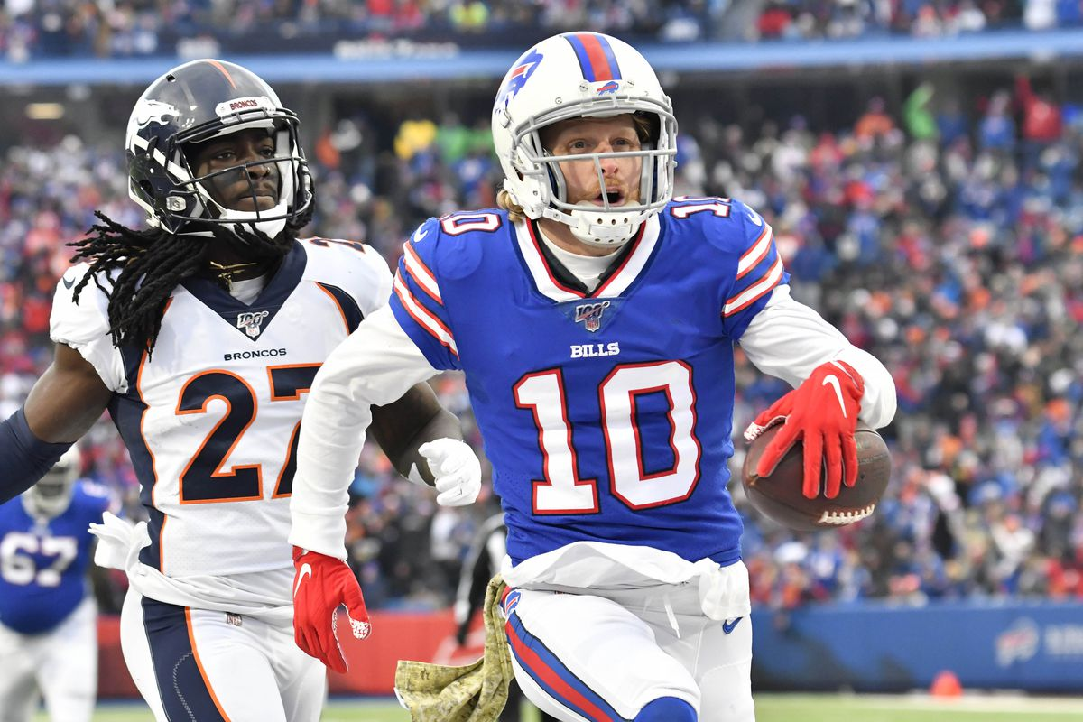 Buffalo Bills wide receiver Cole Beasley reacts to scoring a touchdown in front ofDenver Broncos cornerback Davontae Harris in the third quarter at New Era Field.
