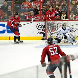Ovechkin Tries to Jump on Open Puck