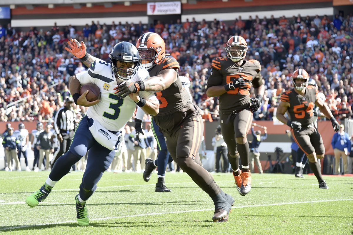 Quarterback Russell Wilson of the Seattle Seahawks is tackled by Sheldon Richardson of the Cleveland Browns during the second quarter at FirstEnergy Stadium on October 13, 2019 in Cleveland, Ohio.