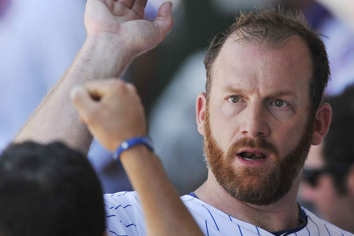 Ryan Dempster of the Chicago Cubs gets congratulated after pitching seven shut out innings against the Boston Red Sox at Wrigley Field in Chicago, Illinois.  (Photo by David Banks/Getty Images)