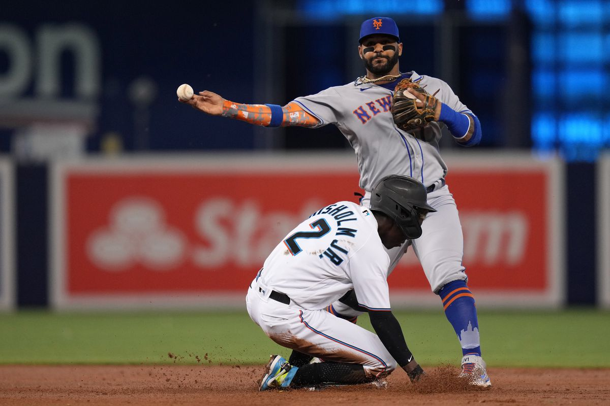 New York Mets second baseman Jonathan Villar (1) gets the force out of Miami Marlins second baseman Jazz Chisholm Jr (2) while turning a double play in the 1st inning at loanDepot park.