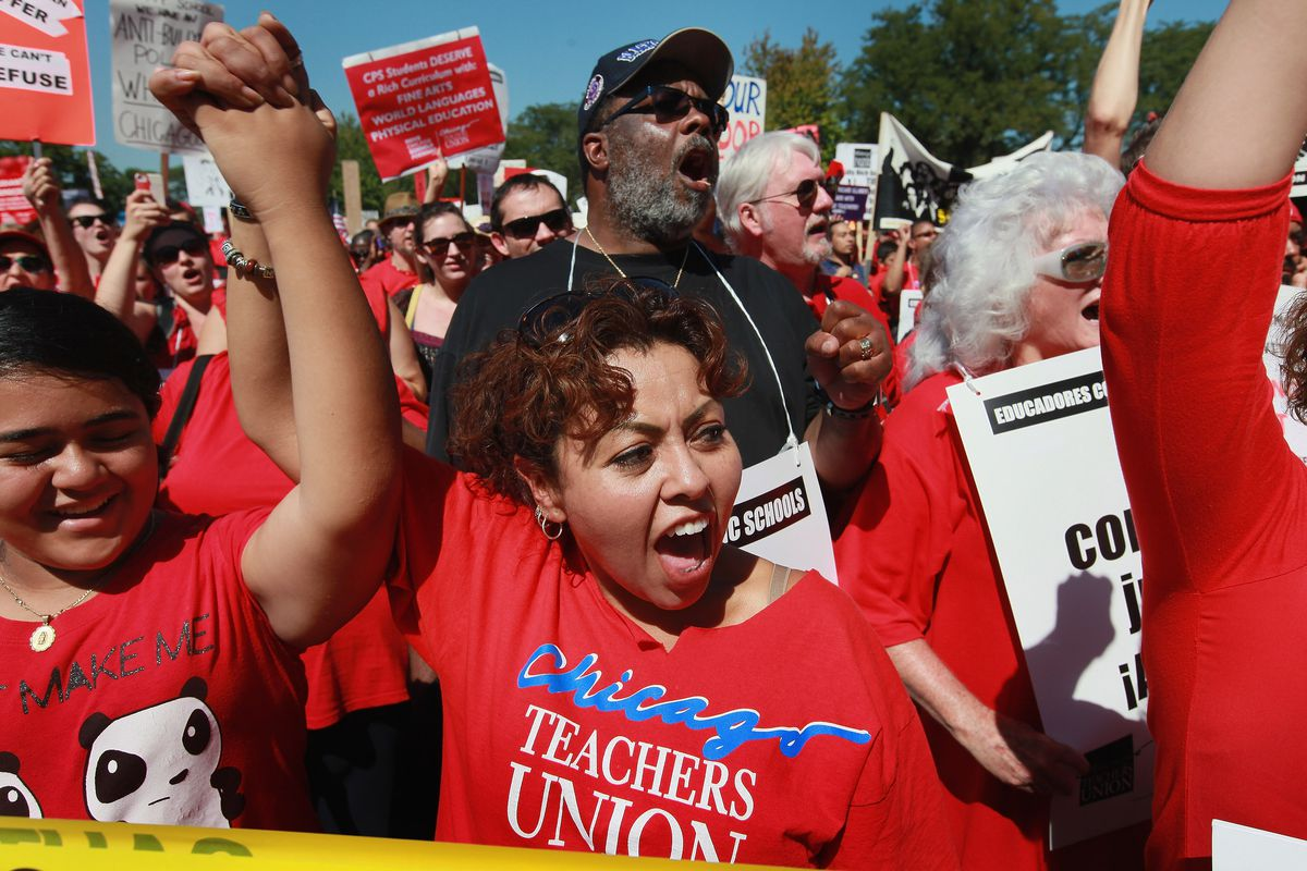 Striking Chicago teachers and their supporters attended a rally at Union Park September 15, 2012 in Chicago, Illinois. An estimated 25,000 people gathered in the park in a show of solidarity as negotiations on a labor contract continued.   (Photo by Scott Olson/Getty Images)