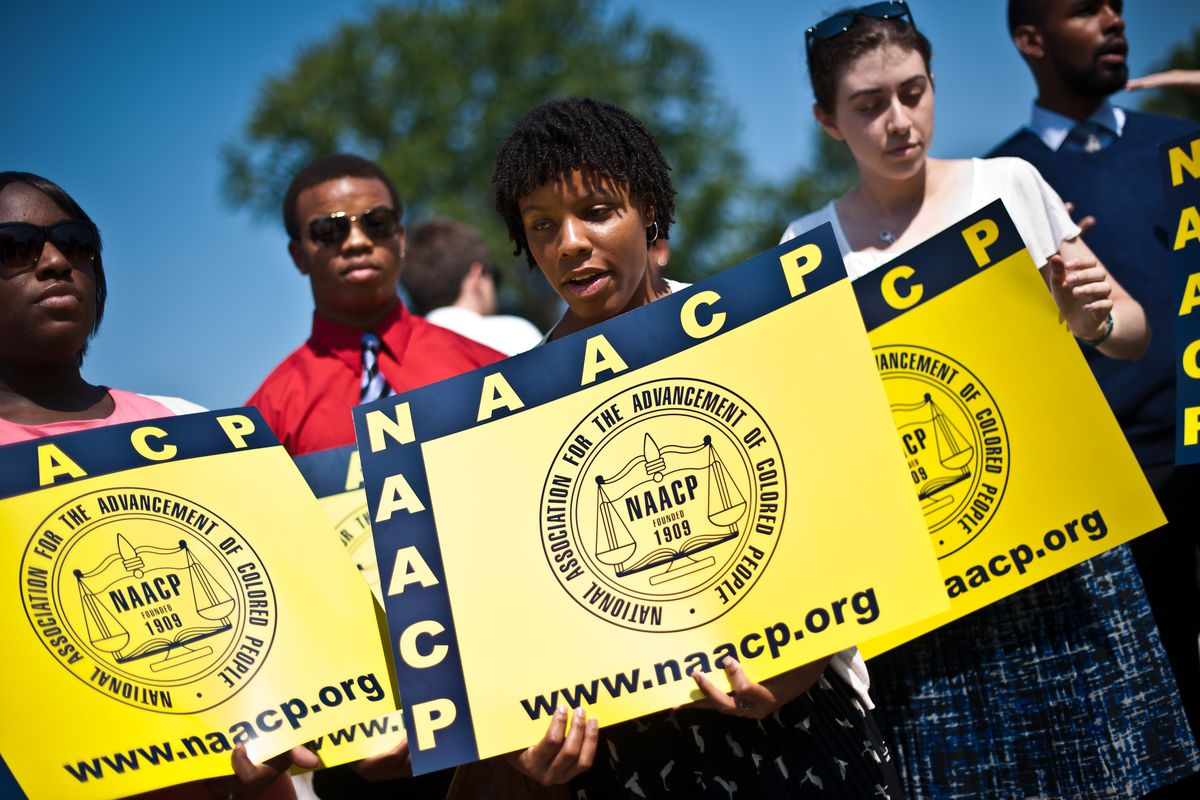 Members of the NAACP protest the Supreme Court's 2013 decision to strike down part of the Voting Rights Act.