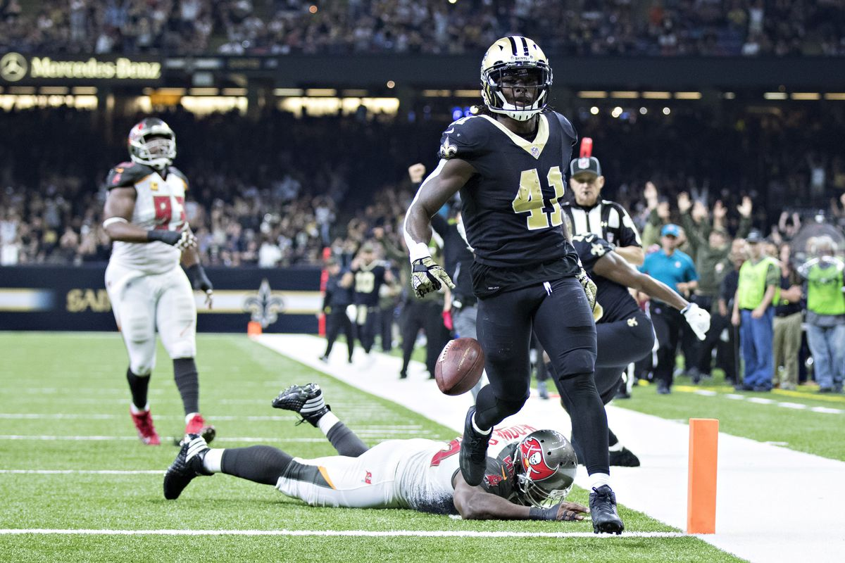 NEW ORLEANS, LA - New Orleans Saints running back Alvin Kamara (41) scores a touchdown against the Tampa Bay Buccaneers defense at the Mercedes-Benz Superdome.