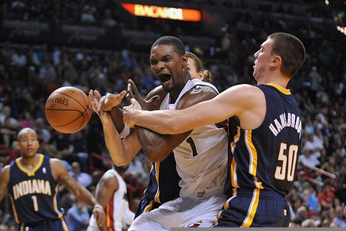 March 10, 2012; Miami, FL, USA; Miami Heat power forward Chris Bosh (1) is fouled by Indiana Pacers power forward Tyler Hansbrough (50) during the first half at American Airlines Arena. Mandatory Credit: Steve Mitchell-US PRESSWIRE