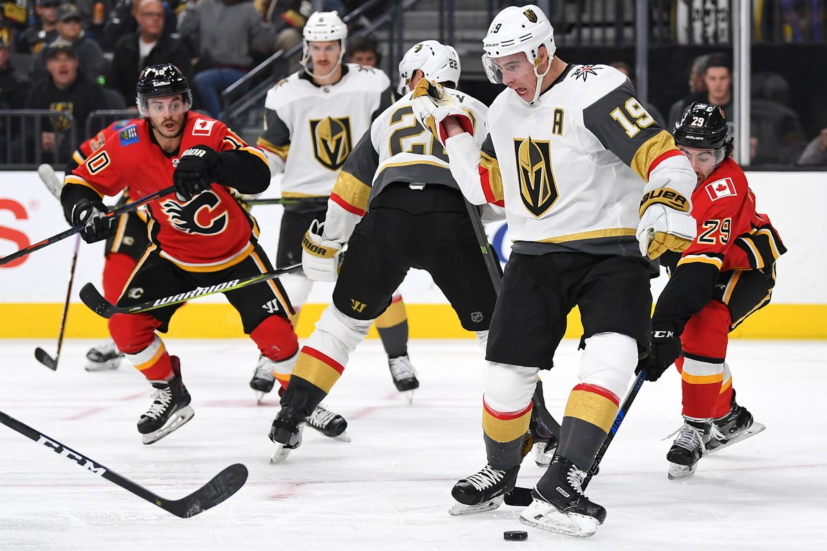 Nov 23, 2018; Las Vegas, NV, USA; Vegas Golden Knights right wing Reilly Smith (19) kicks the puck towards a team mate during the third period against the Calgary Flames at T-Mobile Arena.