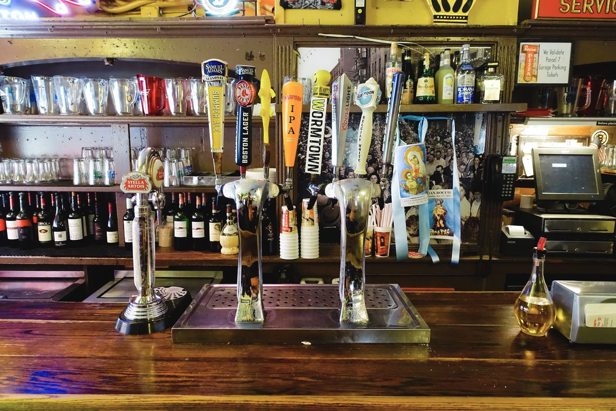 The bar at Regina, featuring taps serving Sam Adams, Harpoon, Wormtown, Blue Moon, and more