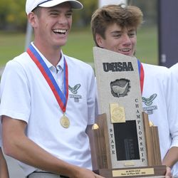 Ridgeline's Zach Skinner, left, celebrates with teammate Fletcher Hamblin after they won the 4A boys state golf tournament on Thursday, Oct. 7, 2021, in Smithfield.