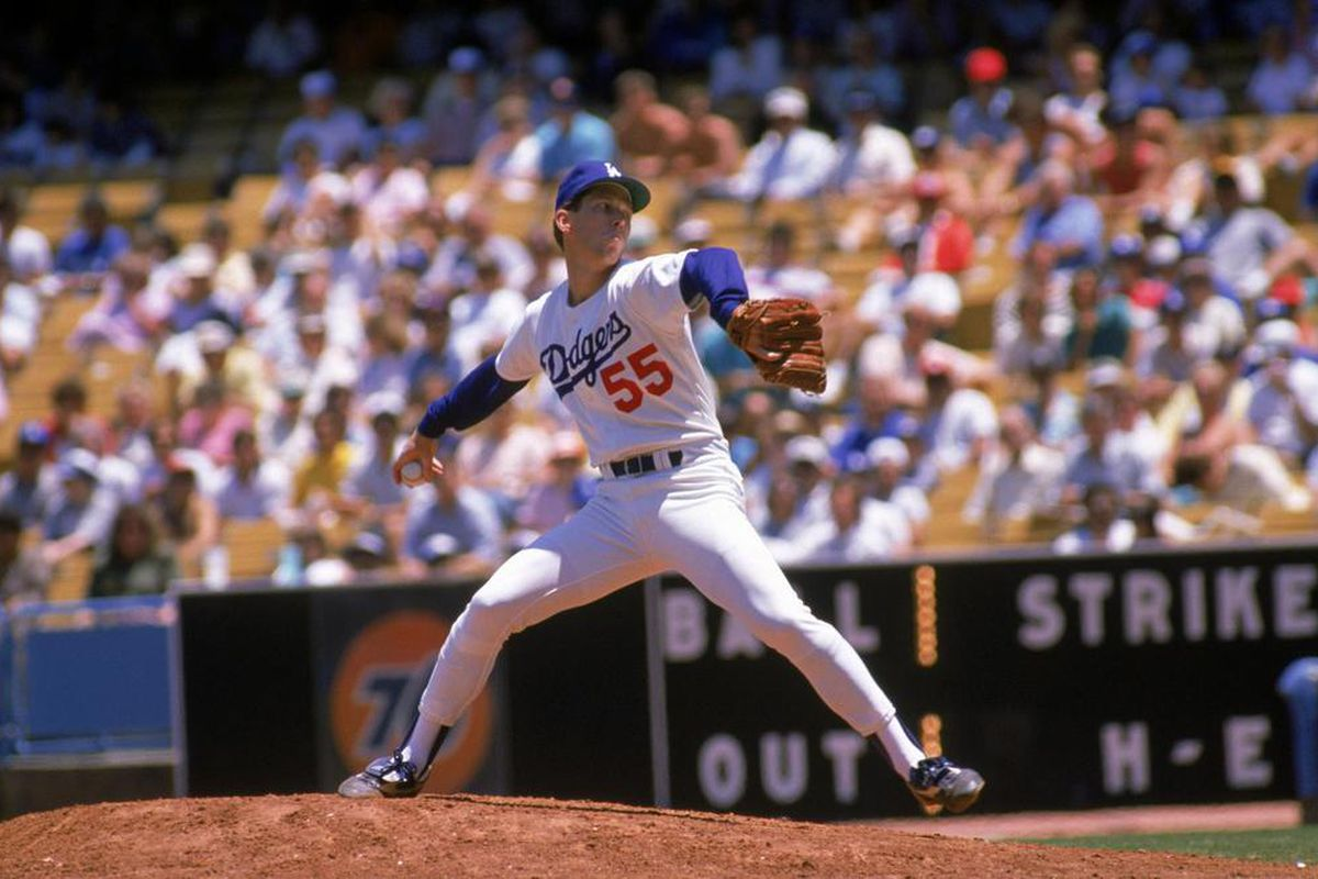 Orel Hershiser won the first seven decisions of his playoff career, a feat accomplished by only Orlando Hernandez (8-0) and Cliff Lee. (<em>Photo credit: Bud Symes / Getty Images</em>)