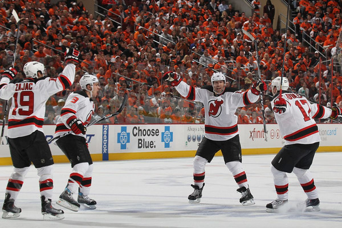 Which one of these three Devils will not be protected in the SBN NHL Mock Expansion Draft? According to Tom, Kevin, and myself, consider the jubilant man on the right. (Photo by Bruce Bennett/Getty Images)