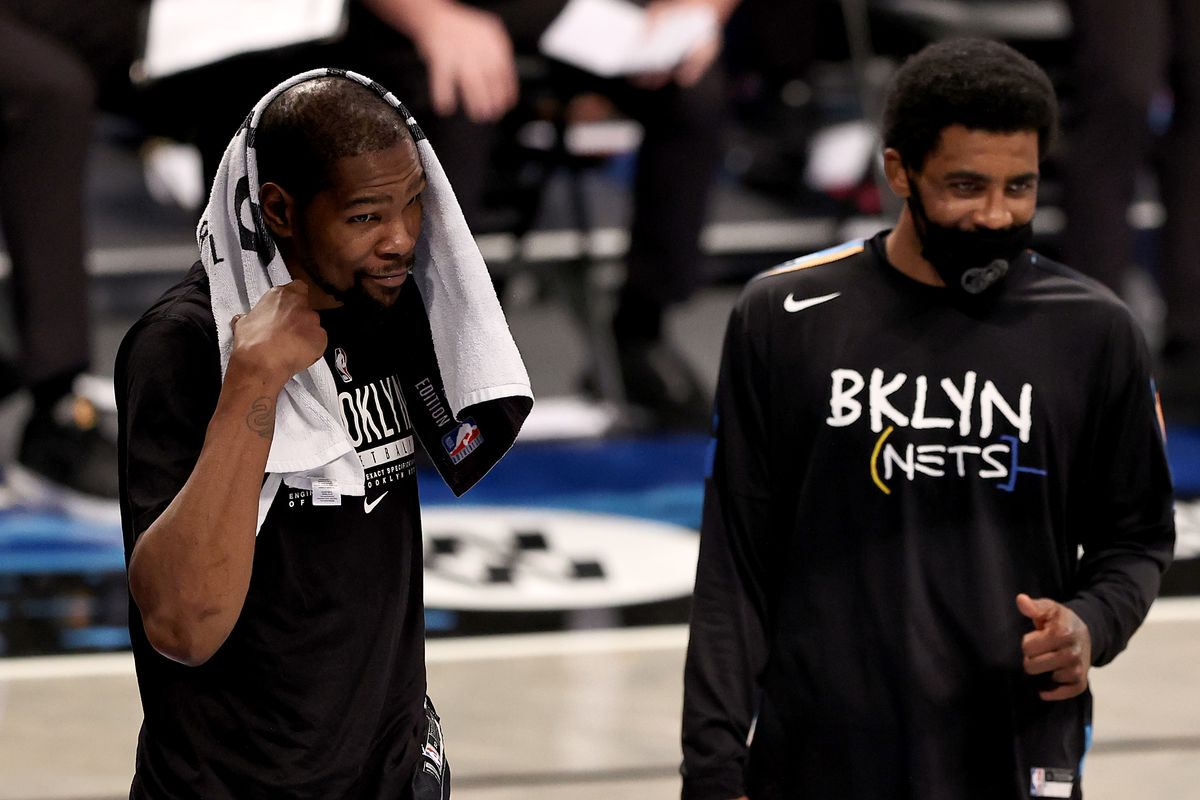 Kevin Durant and Kyrie Irving of the Brooklyn Nets celebrate the win over the New Orleans Pelicans at Barclays Center on April 07, 2021 in New York City.The Brooklyn Nets defeated the New Orleans Pelicans 139-111.