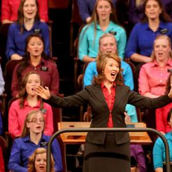 Emily Wadley directs the Relief Society Choir from the Provo Missionary Training Center at the General Relief Society meeting for The Church of Jesus Christ of Latter-day Saints at the LDS Conference Center in Salt Lake City on Saturday, Sept. 28, 2013.