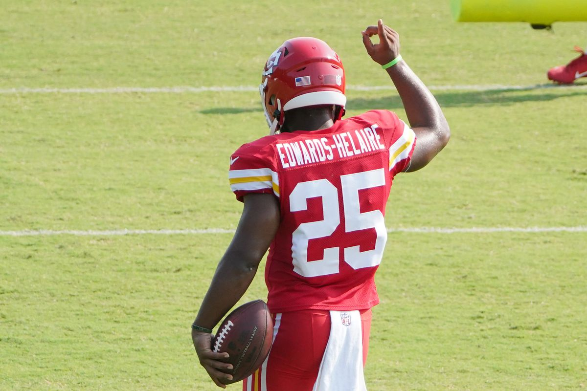 Kansas City Chiefs running back Clyde Edwards-Helaire (25) signals to fans after catching a pass during training camp at Missouri Western State University.