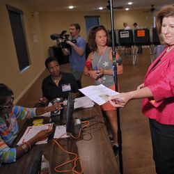 Karen Handel, Republican candidate for Congress, checks in for her voter card Tuesday, June 20, 2017, at the 6th District Special Election at St Mary's Orthodox Church in Roswell, Ga. The matchup of Republican Handell and Democrat Jon Ossoff has become a proxy for the national political atmosphere and a test of GOP strength early in Donald Trump's presidency.
