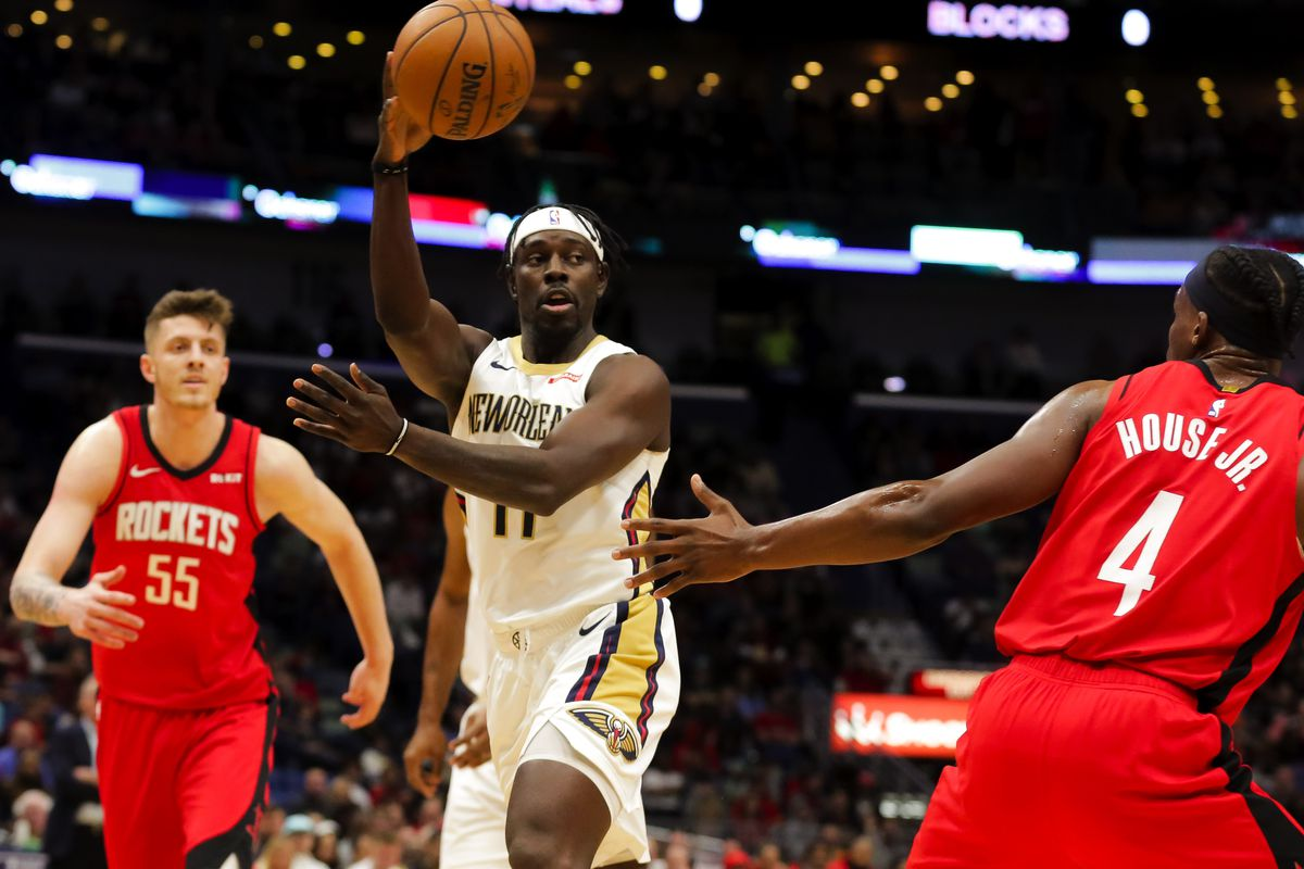 New Orleans Pelicans guard Jrue Holiday passes as Houston Rockets forward Danuel House Jr. defends during the first quarter at the Smoothie King Center.
