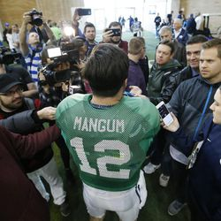 Brigham Young Cougars quarterback Tanner Mangum (12) talks with media after  BYU football alumni day practice in Provo on Friday, March 31, 2017. He discussed the challenge depression has posed in his life during a recent #MentalHealthMatters campaign the university sponsored.