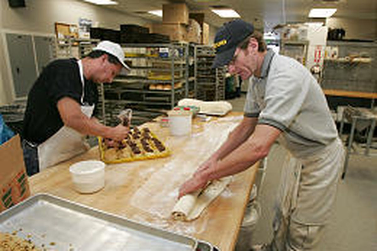 William Alvarado, left, and owner Mike Parsons make rolls and treats at Parsons Bakery in Bountiful.
