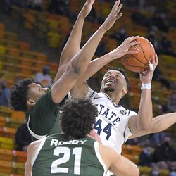 Utah State guard Marco Anthony (44) shoots as Colorado State forward Dischon Thomas and guard David Roddy (21) defend during the second half of an NCAA college basketball game Thursday, Jan. 21, 2021, in Logan, Utah.