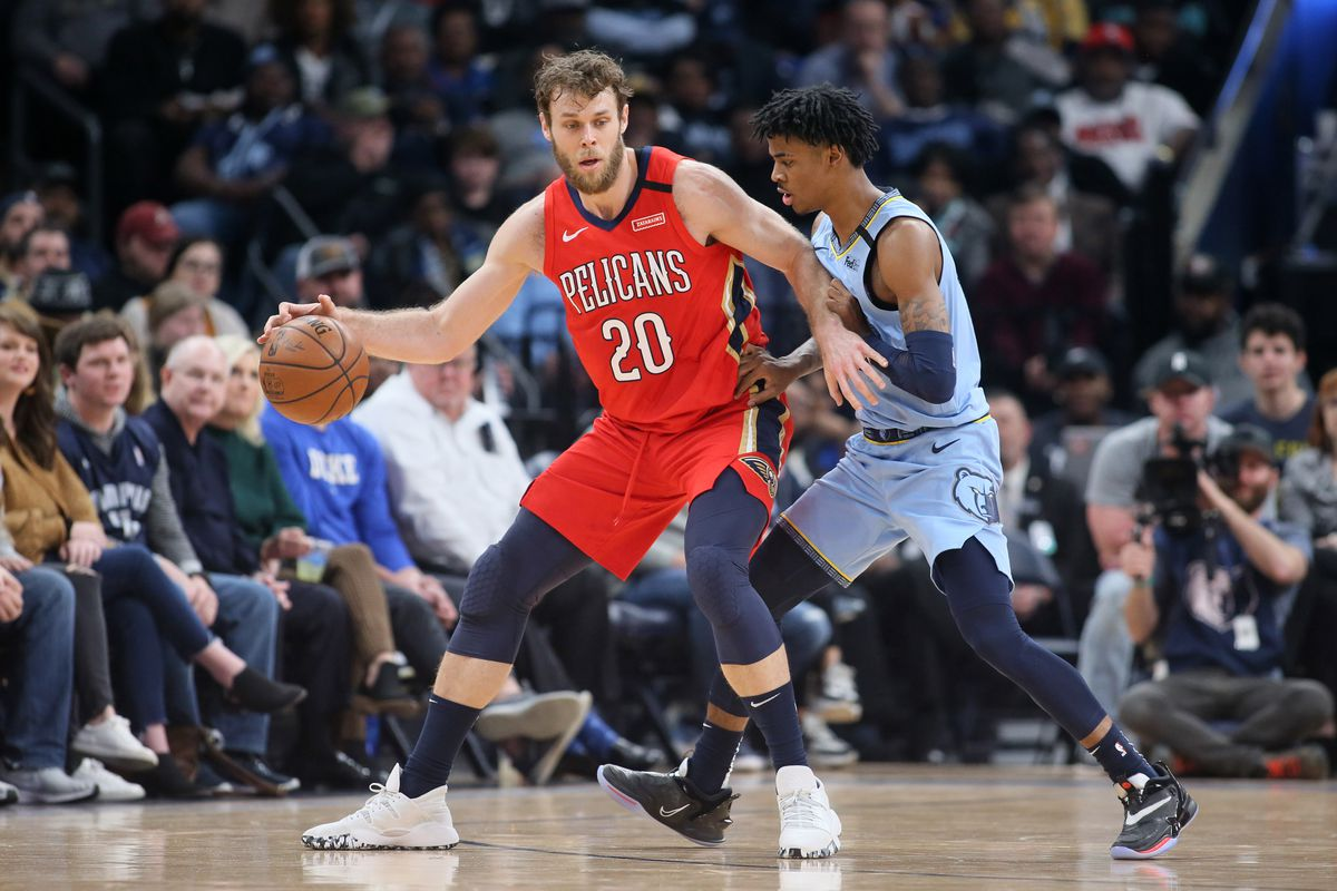 New Orleans Pelicans guard Nicolo Melli drives against the Memphis Grizzlies guard Ja Morant during the first half at FedExForum.