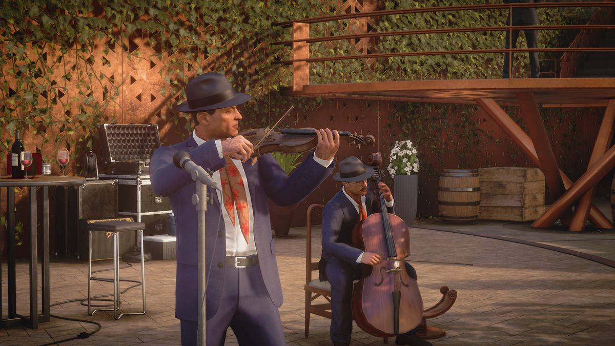 a man in a suit and fedora plays the violin while another man in a suit and fedora plucks an upright bass in Hitman 3
