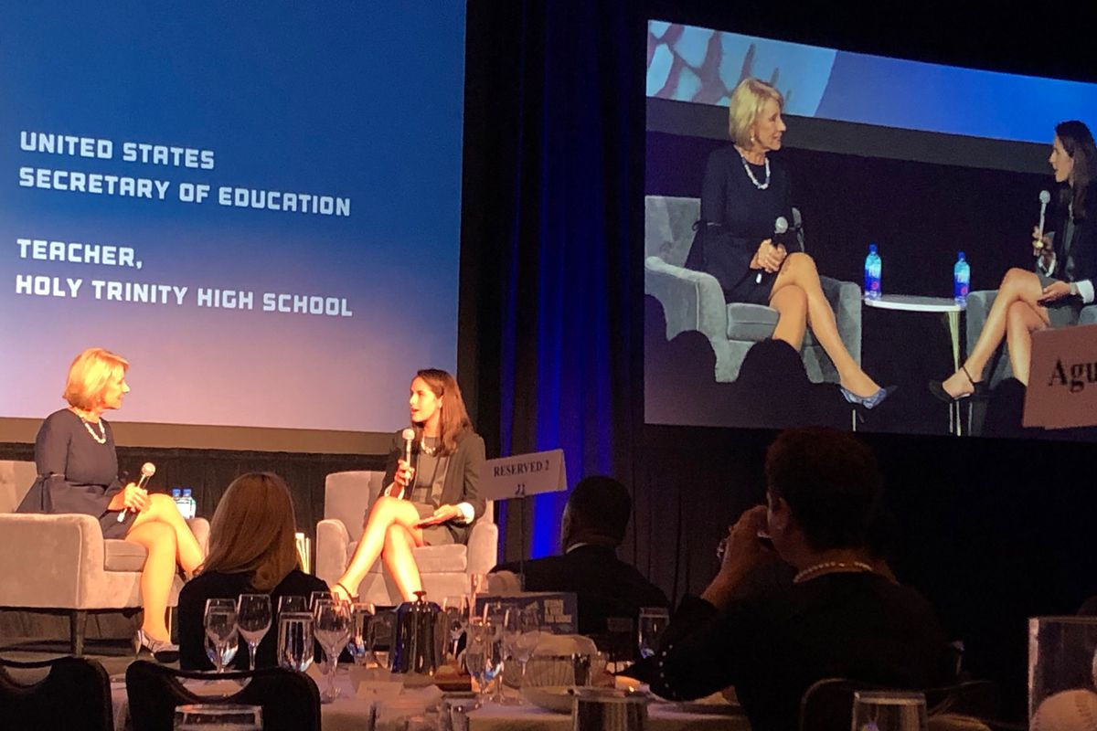 U.S. Secretary of Education Betsy DeVos, left, speaks with Kate Hardiman, a teacher at Holy Trinity High School in Chicago, on May 2, 2019, at the American Federation for Children's national policy summit in downtown Chicago.