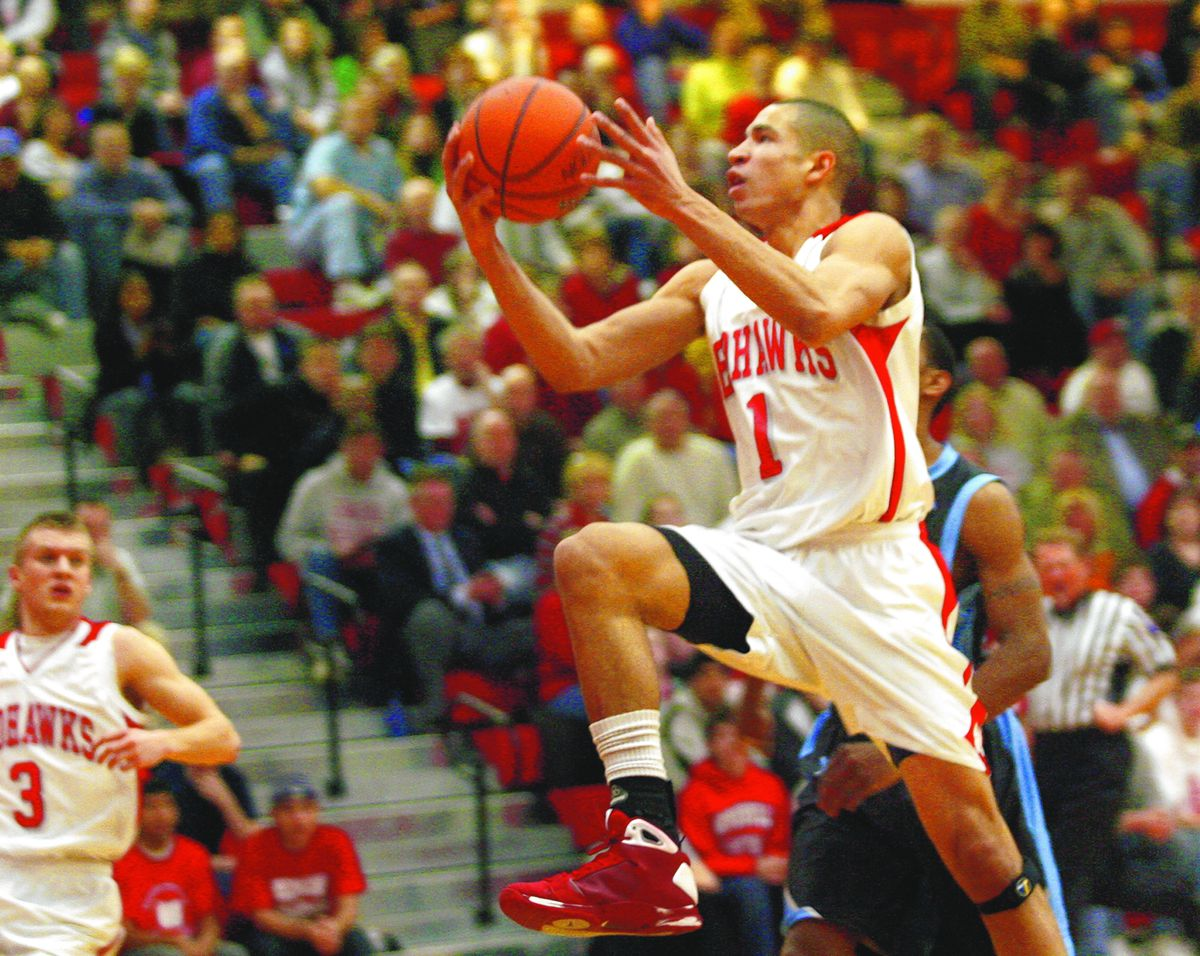 Naperville Central's Drew Crawford puts up two points over Willowbrook.
