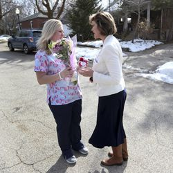 Nicole Maynes, a certified nursing assistant for Visiting Angels, left, and Kathy Sorenson, community relations director for Visiting Angels, talk outside the home of Janet Janis, a client of the in-home senior care company, prior to surprising her with flowers and hugs in Salt Lake City on Wednesday, Feb. 12, 2020. Visiting Angels is delivering hugs to their clients the week of Valentine's Day.