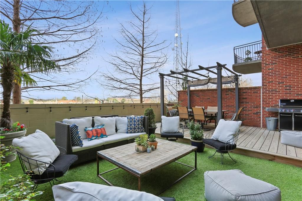 A huge patio in a loft in Atlanta with a view of bare trees.