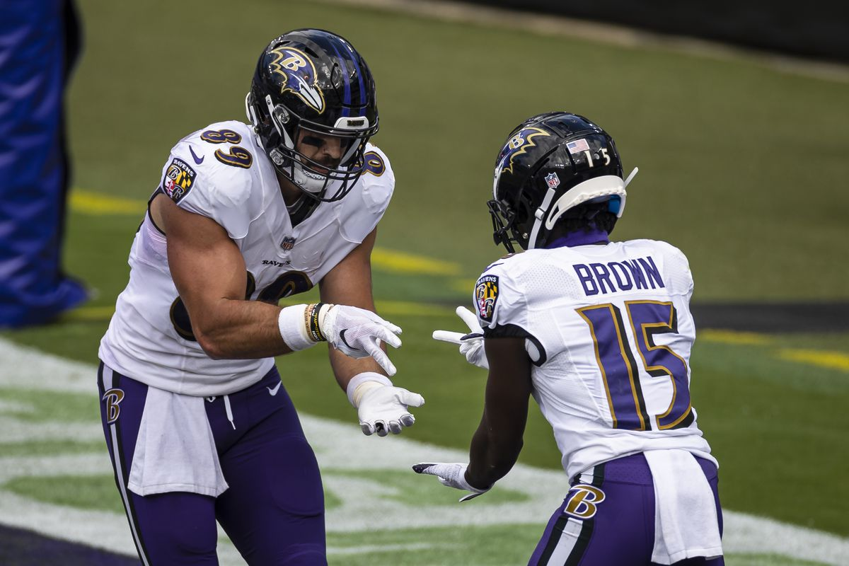 Mark Andrews #89 of the Baltimore Ravens celebrates with Marquise Brown #15 after catching a pass for a touchdown against the Cleveland Browns during the first half at M&T Bank Stadium on September 13, 2020 in Baltimore, Maryland.