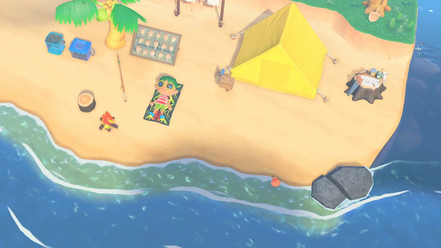 a villager sunning himself on a beach near a yellow tent in Animal Crossing: New Horizons