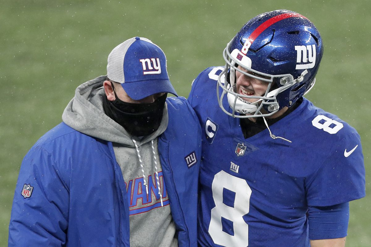 Head coach Joe Judge and Daniel Jones #8 of the New York Giants walk off the field after a game against the Dallas Cowboys at MetLife Stadium on January 03, 2021 in East Rutherford, New Jersey.