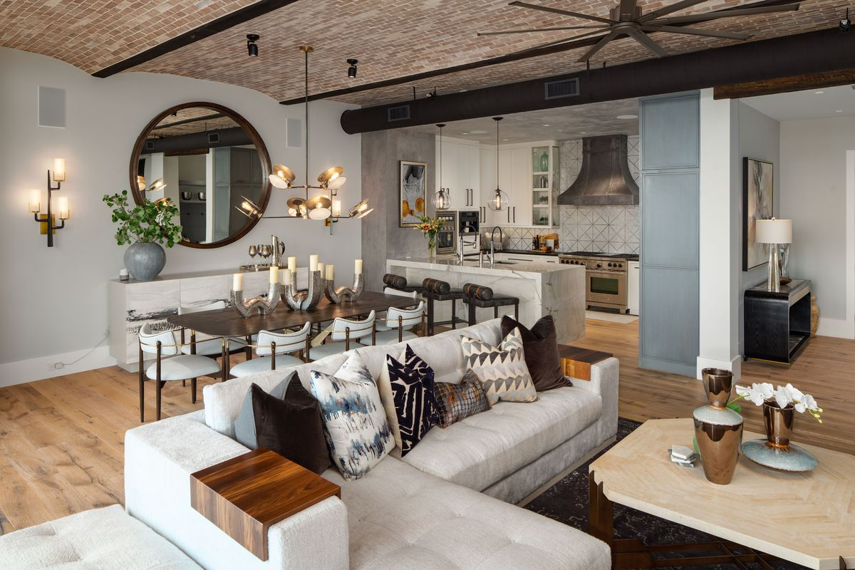 A big living room with brick ceilings.