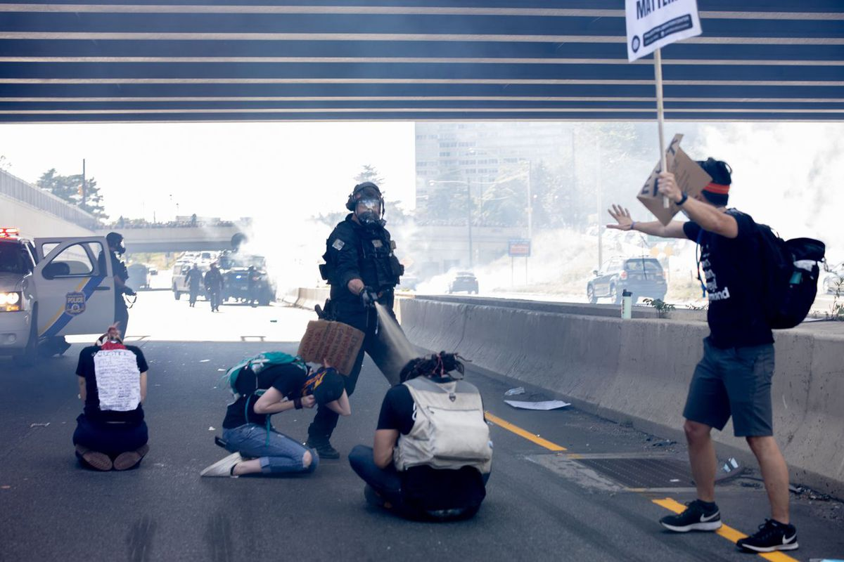 Cops pepper spraying protesters