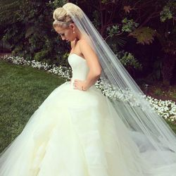 """""""I live by one rule when it comes to wedding styling: <b>classic</b>! A bride wants to feel beautiful and glamorous and I feel it's my job to keep her chic and timeless. Every bride has their own unique style and my client's [simple updo] look here is ins"""