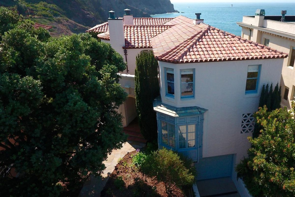 An aerial photo of 320 Sea Cliff's tile roof and view of the Golden Gate.