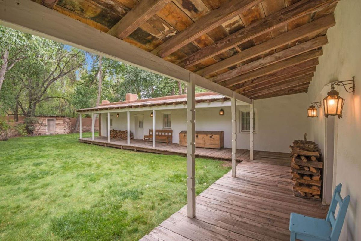 Rustic adobe home asks 895k in santa fe curbed for Territorial style house plans