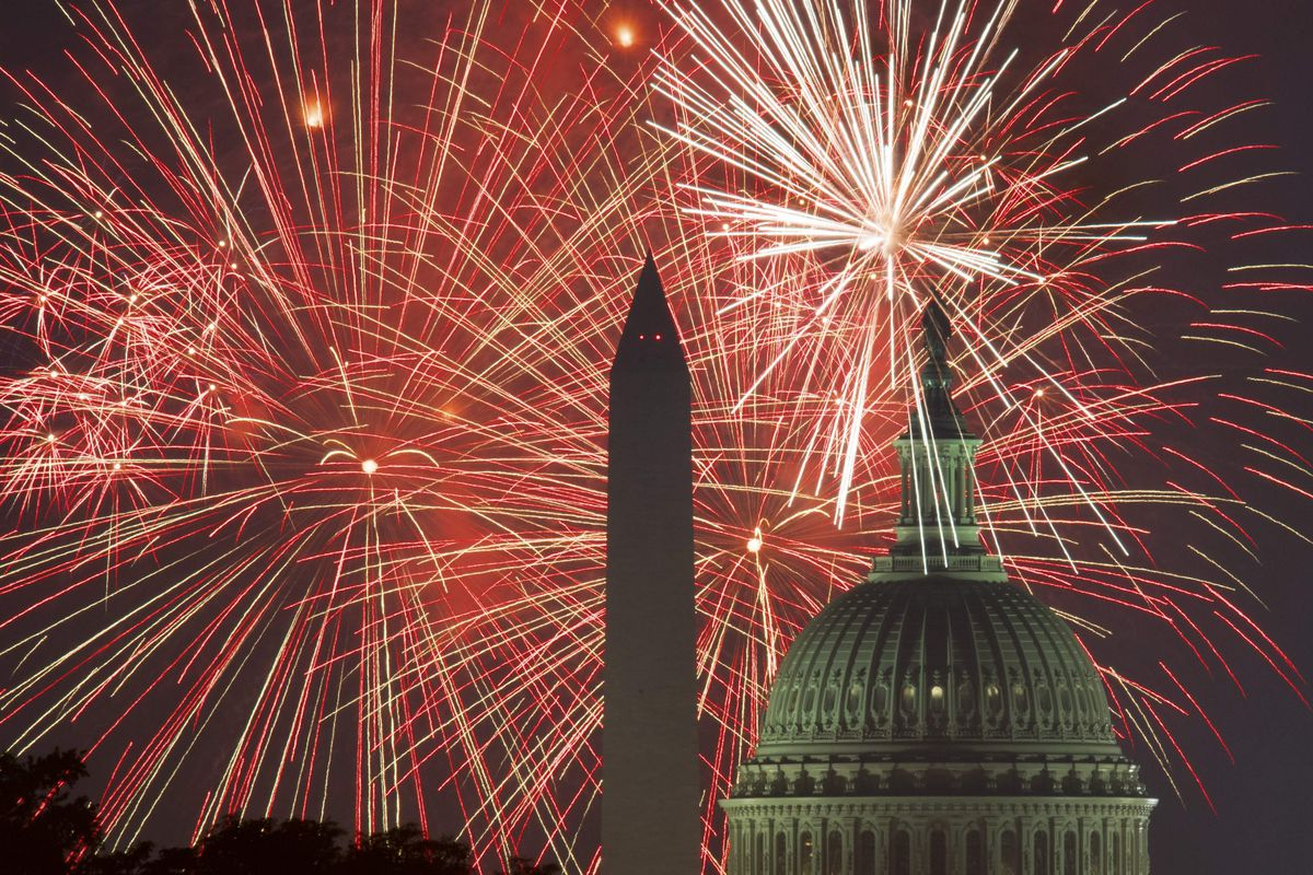 Fireworks over the Washington Monument and U.S. Capitol.