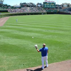 12:39 p.m. Coach Brandon Hyde playing catch with his son -